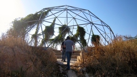 Our geodesic dome's plants begin to cover it's sides.